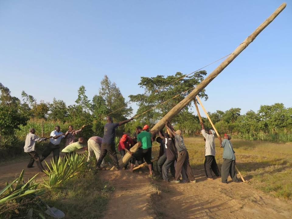 doing a Harambee to lift a lamp post in Kenya