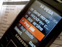 A mobile screen showing M-Pesa and how to pay bills