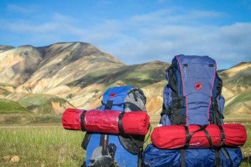 two bags resting in the mountains in the middle of nowhere