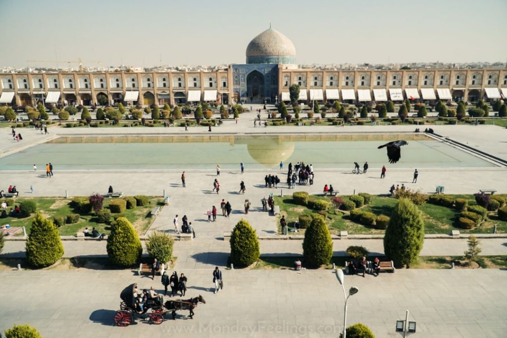Naqsh-e Jahan Square in Isfahan with many people and birds