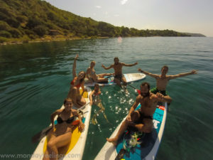 people on Stand-up Paddle in Malawi Lake
