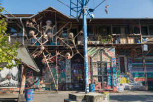 House full of graffti and artistic installations in Metelkova