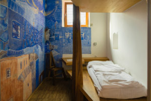 A cell room painted by an artist in Celica hostel