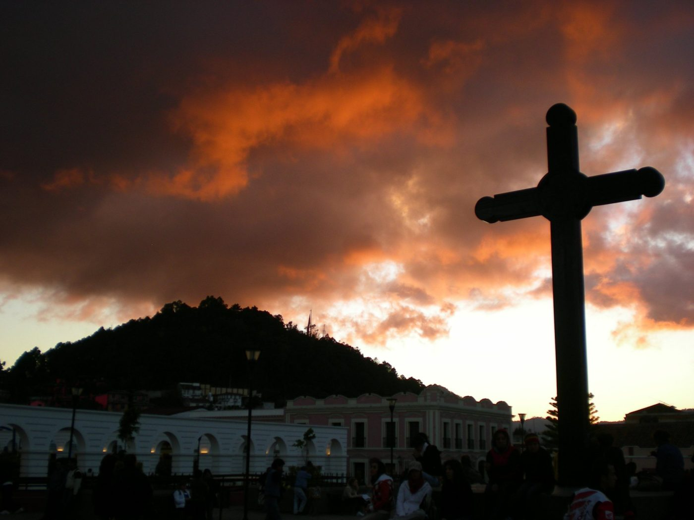 A cross during dawn in a Mexican town