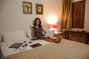 Fe working in the bed of the Flor de Debora Inn