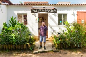 the owner of Flor de Debora Inn at the entrance