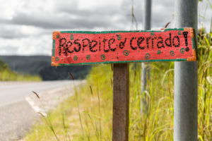 Sign saying to respect the cerrado